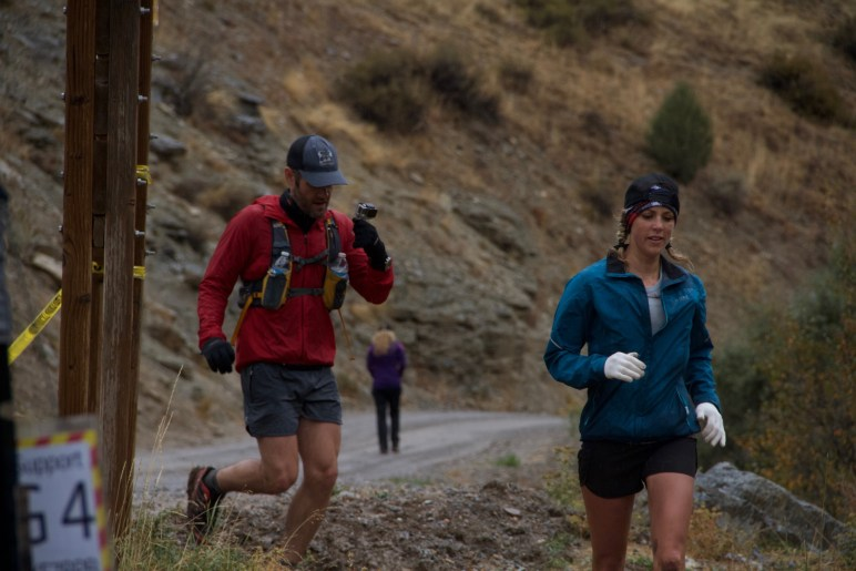Chelsea Hathaway running into the Temple fork aid station with pacer Aaron Williams at the 2016 Bear 100