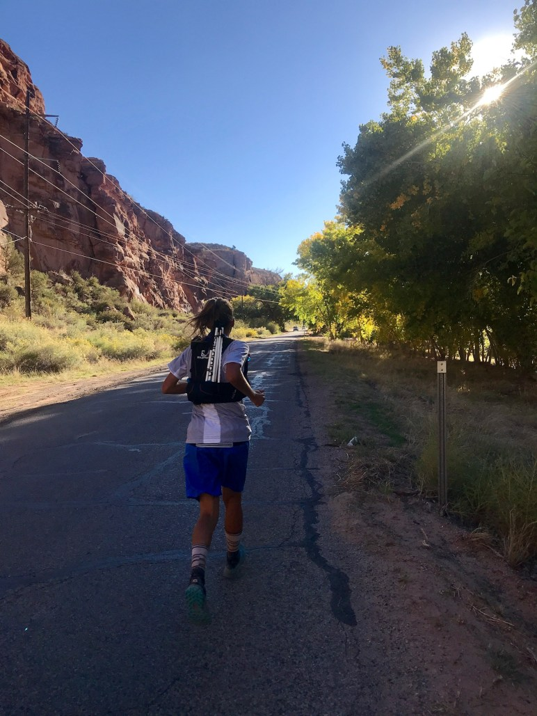 Courtney Dauwalter running a road in the Moab 200