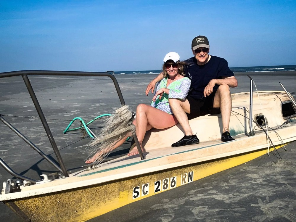 Couple Sitting on a beached ship on Waities Island in North Myrtle Beach, South Carolina