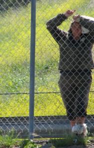 homeless woman thru fence_0524