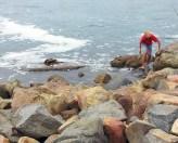 boy-inred-short-ob-rocks