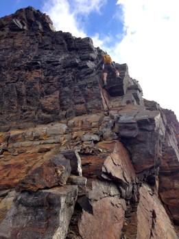 Jim Downclimbing To North Ridge Notch
