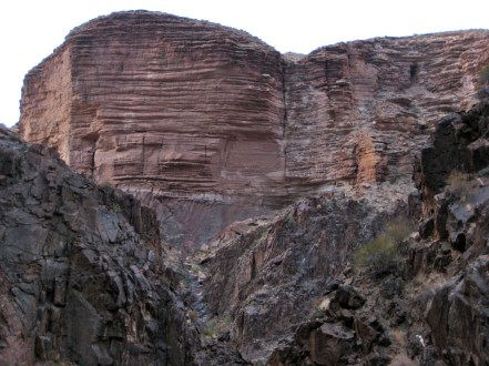 Stratified Cliffs Above River