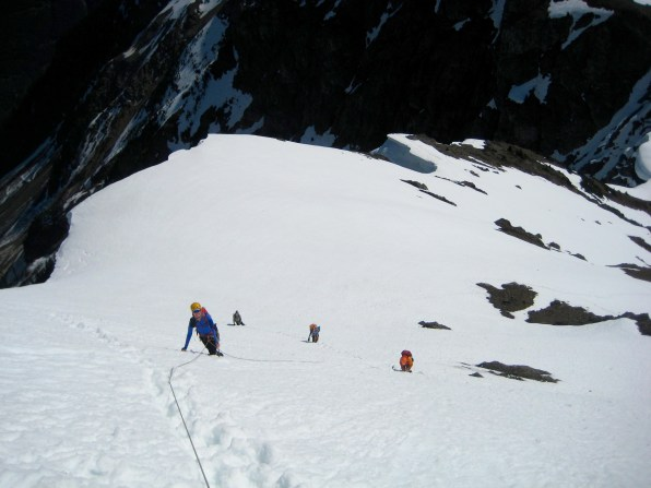 Group Climbing East Face Of Mount Rideout