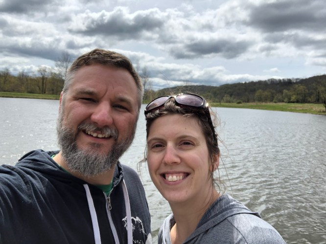 Man and woman in front of lake