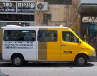 A picture of a shuttle van from Nesheret Tours