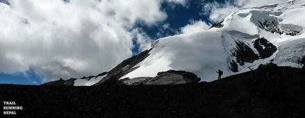 Emma climbed a ridge above the pass