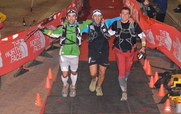 Transgrancanaria 119k finish line: Runners crossing in #105 share the joy after 22h11m.