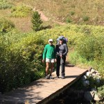 trail volunteers crossing trail bridge on the Colorado Trail
