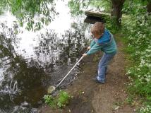 One of our Watch members pond dipping from the bank.