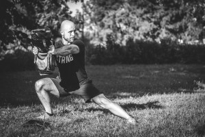 personal trainer mobility exercise with DVRT sandbag at Training Unity UK