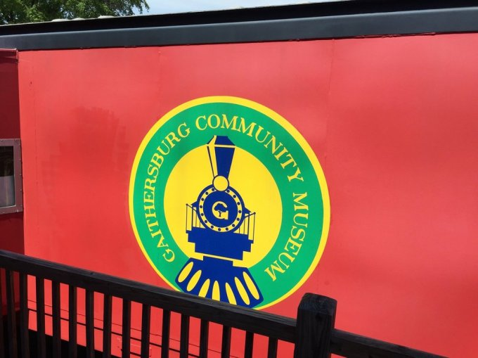 The Museum logo on the side of the caboose.