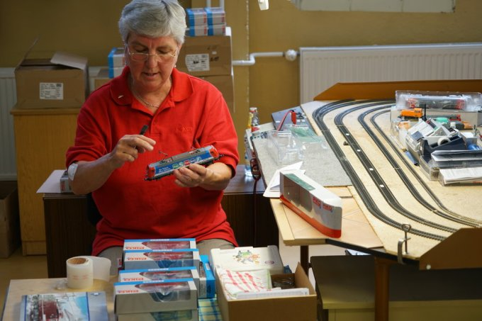 The last station: HO scale locomotive quality control and packaging.
