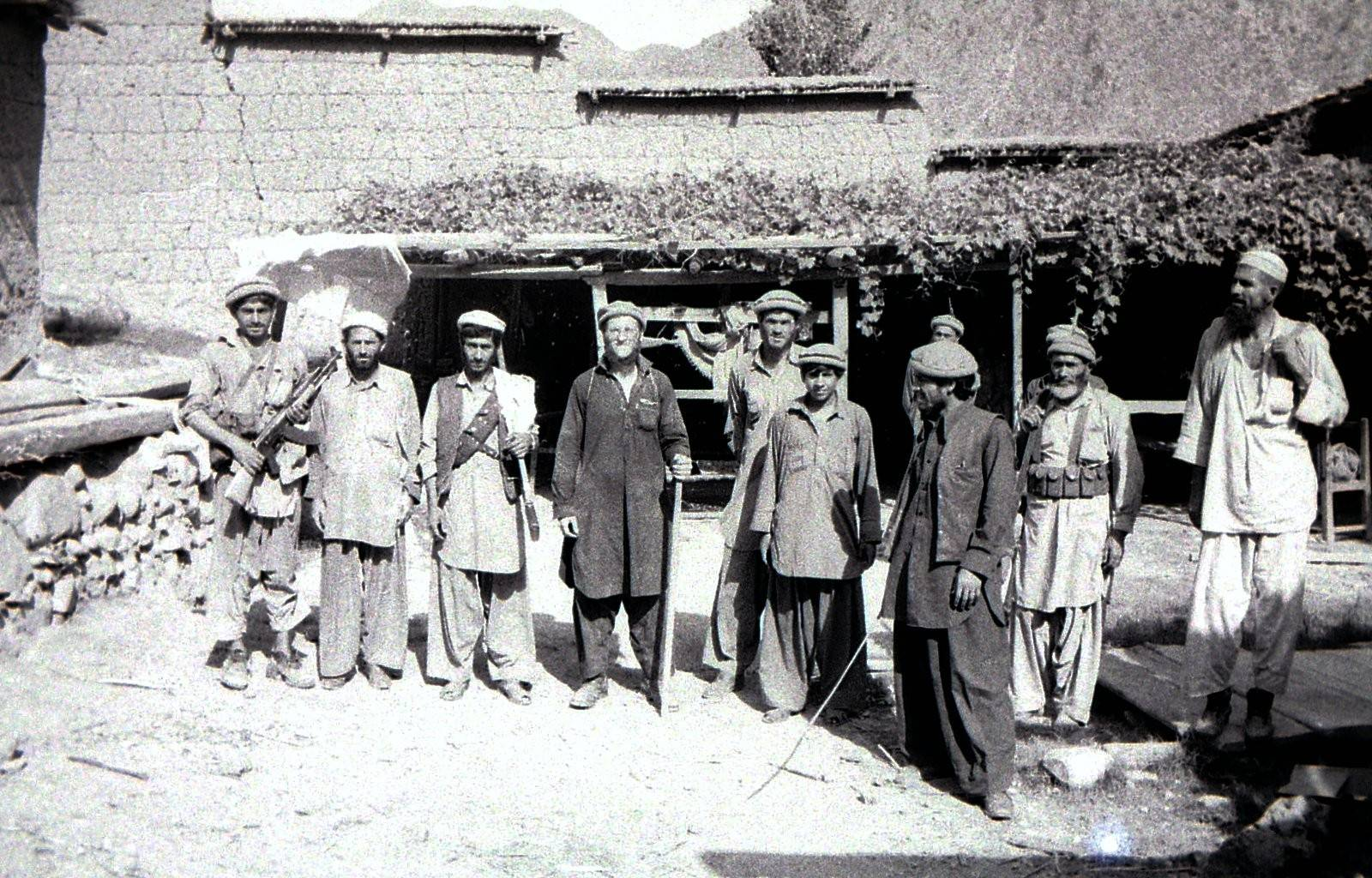 Tramp11 with mujahideen at bombed-out Sao village -Kunar Valley Afghanistan August 1985