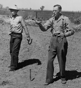 Photo of two men playing horseshoes