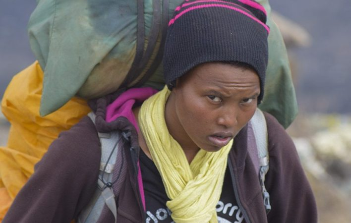 A female porter conquers Mount Kilimanjaro with a 20-kilogram bag on her shoulders. PHOTO | eTN