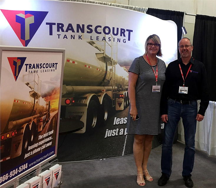 Truxpo-2016-1 Former world champion curler Georgina Wheatcroft is seen here with Kevin Quick, Vice-President of Business Development at Transcourt.