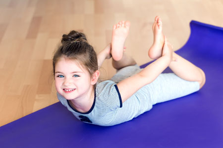 yoga-girl-on-mat-sm