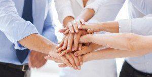 bigstock-Businesspeople-Holding-Jigsaw--63248317