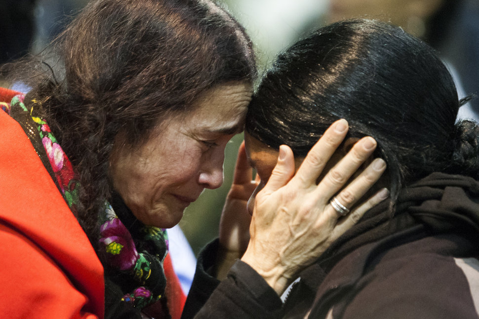 Maria D. Michael, a Lakota elder from San Fransisco, Calif., embraces veteran Tatiana McLee during an emotional forgiveness ceremony at the Four Prairie Knights Casino & Resort on the Standing Rock Sioux Reservation on Monday, Dec. 5, 2016.