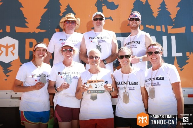 Team photo with race medals at Ragnar Trail Tahoe.