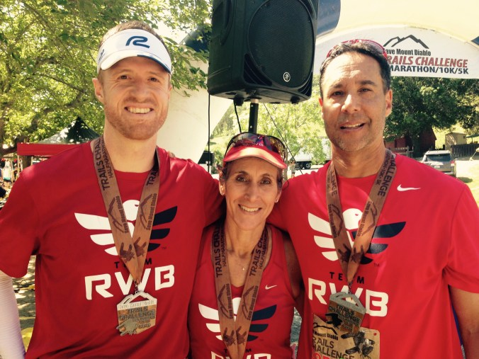 Team RWB friends posing with race medals after Mt. Diablo Trails Challenge
