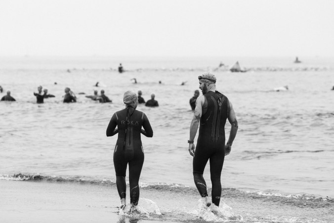 Shari and I going for a warm-up swim at Ironman 70.3 Santa Cruz