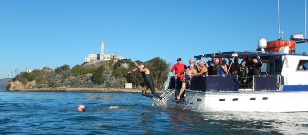 Swimmers jumping off the boat near Alcatraz for Take the Rock 4.0