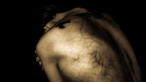 woman's back covered in veins, sadness
