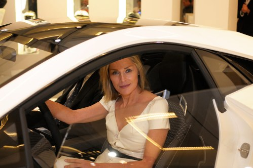 Hollywood actress Sharon Stone sitting in the new Esprit