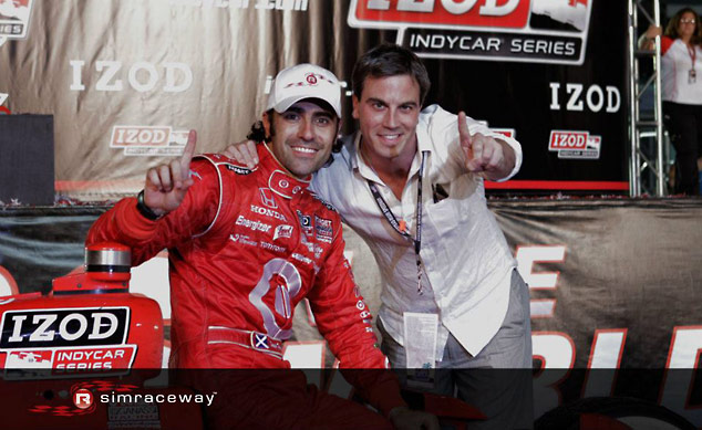 Simraceway CEO Jonathan Haswell joins in the celebrations with 2010 IndyCar Series Champion Dario Franchitti