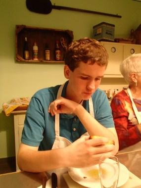 Sam finishing off his simple bruschette