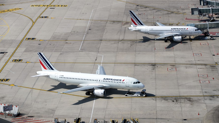 Picture taken on June 27, 2019 shows an Airbus A320 and an Airbus A318 (rear R) airplane of the Air France airline company parked on the tarmac of Roissy-Charles de Gaulle Airport, north of Paris.