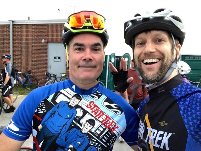 Two cyclists with Star Trek jerseys