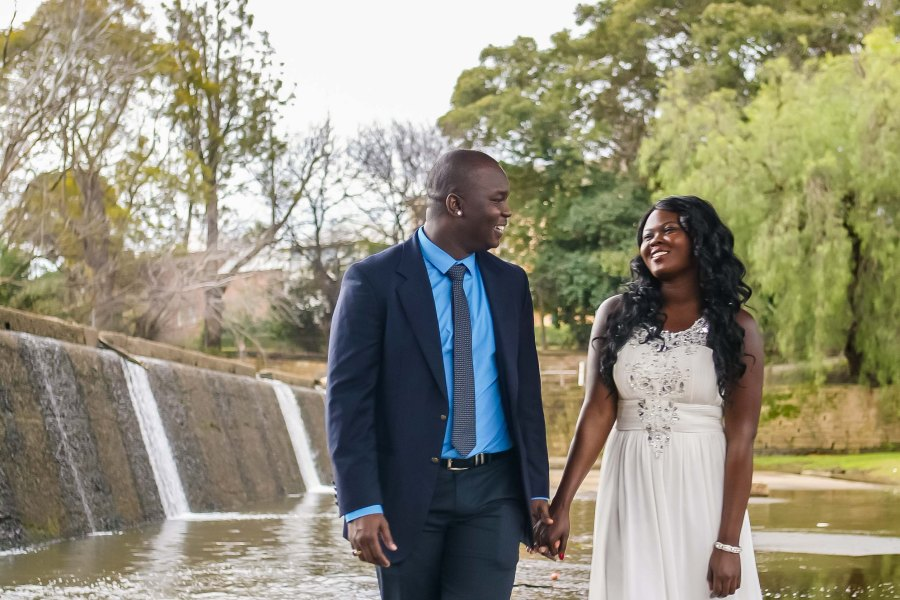African australian wedding couple walk and look at each other