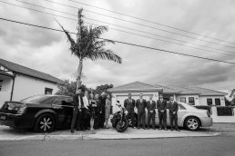 Sydney wedding photography of the entire groom's family and chrysler