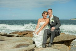 Sydney wedding couple sitting on rocks at cronulla beach