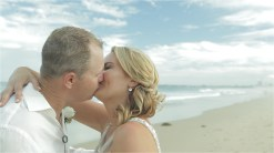 Australian wedding couple kissing at wollongong beach