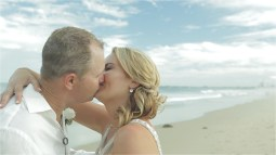 Australian wedding couple kissing at wollongong beach