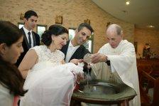 Sydney Baptism photographer capturing the mum and dad baptising baby