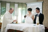 Sydney baptism photographer capturing the baby and the godparents