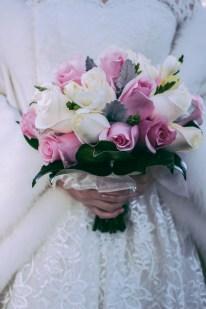 Australian asian bride holds her beautiful bouquet