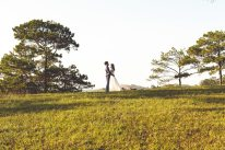 Sydney wedding couple hold each other on a nice hill