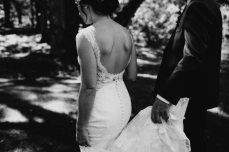 Black and white photo of a bride with lace dress