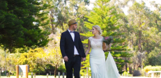 Australian wedding couple look at each other whilst walking
