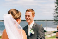 groom looks at his beautiful bride on wedding day