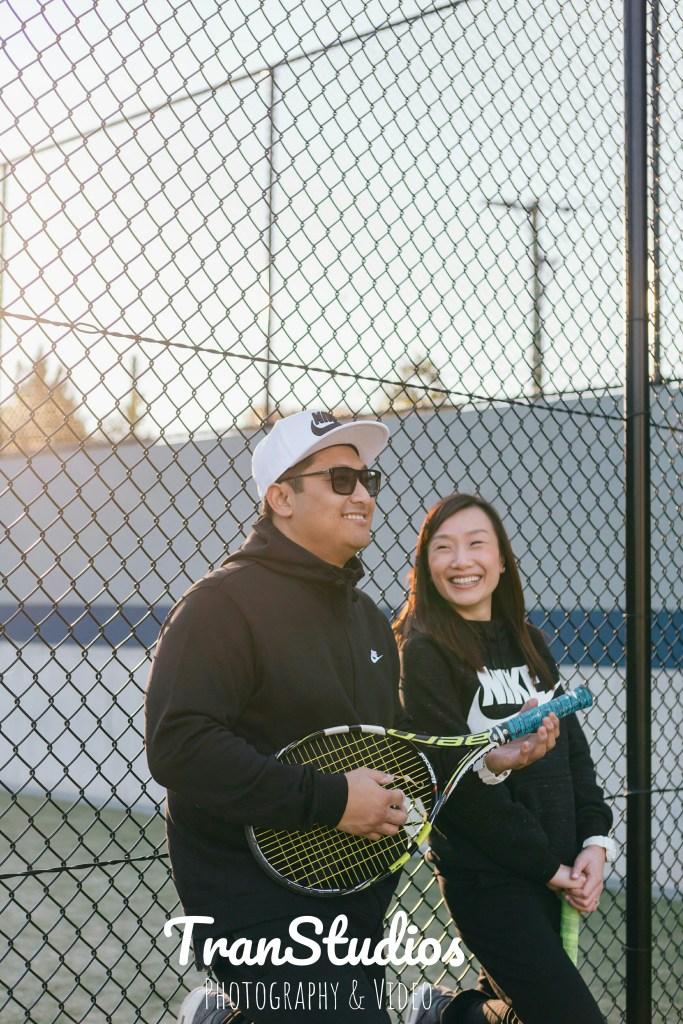 beautiful engaged couple playing tennis at waitara tennis courts