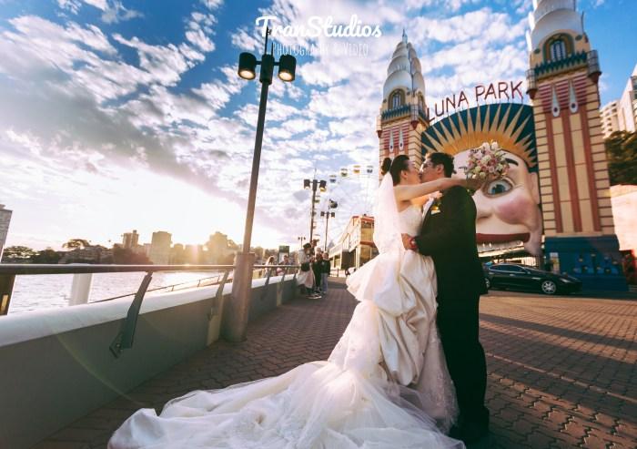 Beautiful wedding couple at luna park sydney kissing photography
