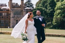 Hungarian bride and assyrian groom walking at royal botanical gardens