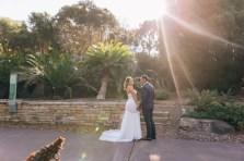 bride and groom look at camera